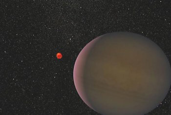 Artist's impression of the planet, believed to be 1.5 times larger than Jupiter, orbiting its tiny parent star, a red dwarf. The distance between the star and planet is three times the distance between Earth and the Sun. (Credit: NASA)