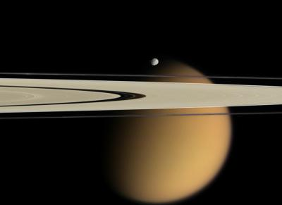 Saturn's A and F rings, the small moon Epimetheus and the smog-enshrouded Titan, Saturn's largest moon. (Credit: NASA/JPL/Space Science Institute)